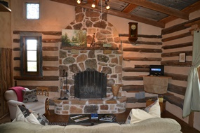 The fireplace and living room at Grindewald Swiss log cabin