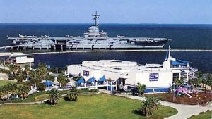 Texas State Aquarium with the USS Lexington in the background