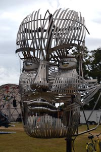 Metal sculpture with moving face parts