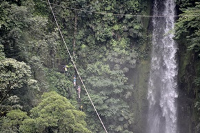 zip line and rappel next to a waterfall