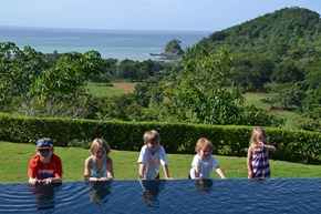 The grand kids at the edge of the infinity pool