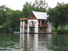 a boat house on Lake Austin, you should see the house