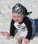 8 month old grandson enjoying the sand