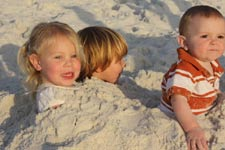 Grandkids buried in the sand