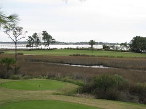 Tough Bay Point golf hole - carry wetlands twice to small landing zone