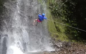 Costa Rica rappelling down a waterfall