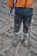 Muddy shoes and clothes