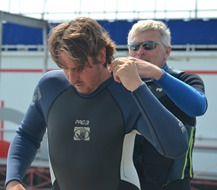 Trying to get into the wet suit