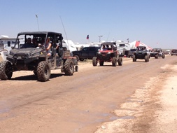 a line of ATVs at Crude Fest