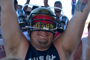 Football helmet with beer cans