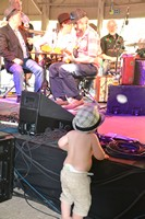 the cute beer bellied bow legged little boy with no shirt and diapers coming out the top of his pants - he would run up to the front of the stage and start dancing