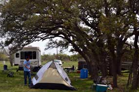 Camping under the few trees in the Luckenbach Parking Lot