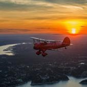 Romantic sunset flight with Austin Biplane