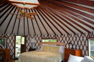 Inside a tree house yurt  at Rainbow Hearth
