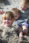 Covering the grand kids in the sand