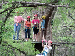 Zip line from the trees at Cypress Valley Zip Line Tours