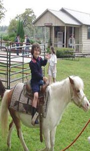 Riding the pony at Flying L Guest Ranch