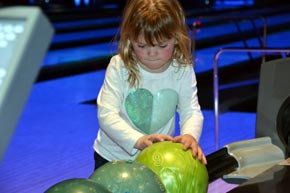 The granddaughter getting ready to bowl a strike