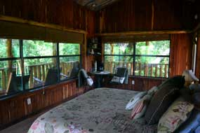 Comfortable bed  in the tree house at Cedar Mountain Lodge