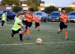 Cole playing soccer