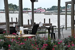 Sitting on the deck at Wolfies on Lake Conroe