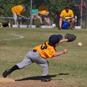 Cole getting the runner out at first base